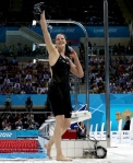 Missy Franklin wins the 200m Backstroke at the 2012 Olympics.  Sourced from: http://www.nydailynews.com/sports/london-olympics-2012-evolution-olympic-swimsuits-gallery-1.1130201?pmSlide=16