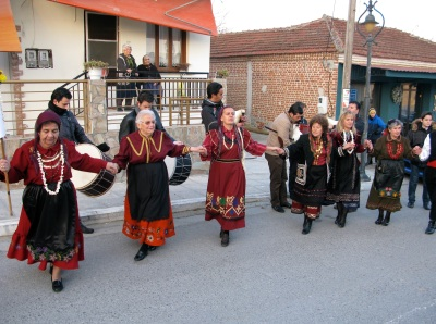 Kyria Fotini holds the flag and leads the dance in Kitros.