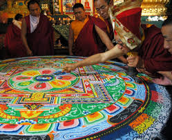 Wiping off a sand mandala is a practice of letting go of identity: it can be beautiful and a lot of work has gone into it, but it's better to let it go