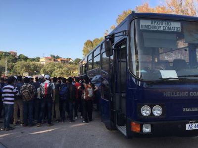 Refugees awaiting transport