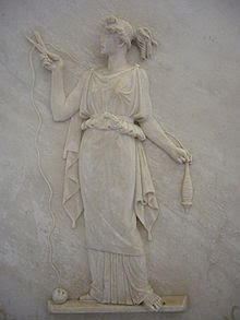 Bas relief of Atropos, shears in hand, cutting the thread of life