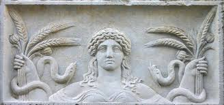 Temple relief of Demeter with grain, poppies, snakes, from Eleusis.