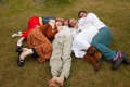 A group of people lying on the ground together, laughing