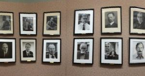 Professors who've made a significant contribution to their field. Three walls, two-deep of white men.