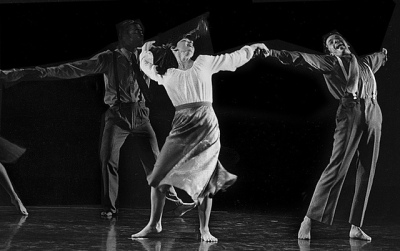Joyful dancers move ecstatically