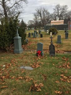 most-holy-trinity-cemetery-with-grave-of-george-and-fred-white-carnations