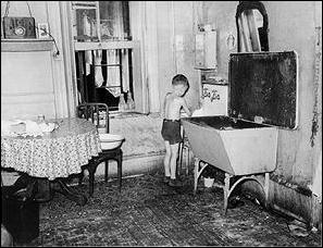 tenement-housing-boy-at-sink