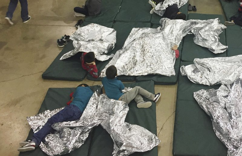 chldren at the border immigrant kids seen held in fenced cages at border facilityjpg