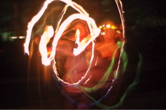 the author spins fire, surrounded by trails of flame light