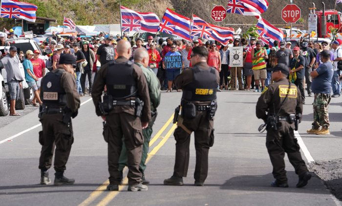 TMT-demonstrators-chant-as-State-Sheriffs-stand-on-Mauna-Kea-Access-Road2-1188x719.jpg