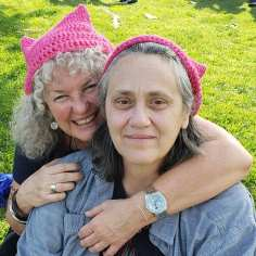 Picture of author, Marie Cartier (left) and her partner, Kimberly.